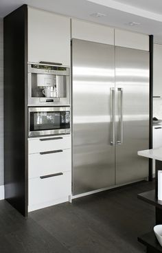 Design ideas for a contemporary kitchen in Toronto with an undermount sink, flat-panel cabinets, white cabinets, quartzite countertops, white backsplash, stone tile backsplash and stainless steel appliances.Inspiration for a contemporary kitchen in Toronto with gray backsplash.Contemporary kitchen in Toronto with stainless steel appliances.Transitional eat-in kitchen in Toronto with flat-panel cabinets and white cabinets.Inspiration for a modern kitchen in Toronto.Photo of a modern kitchen…