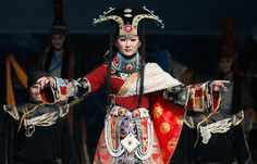 An actor from Russia's Tuva region, dressed in costume, performs traditional music during the opening ceremony of the third International Music Festival of Asian-Pacific Region in Krasnoyarsk, on June 29, 2012.