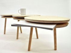 pillar table by martin hass -a modular two legged low table system that can be extended indefinitely using discs sandwiched between table top & bottom. space that isn't used to dock two units together can be used for storage of magazines or books.