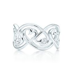 Searching for the perfect anniversary gift? This stunning swirling infinity ring will be a unique addition to her jewelry collection.