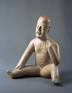 Pre-Columbian Art | Denver Art Museum | Seated Figure. Mexico, Guerrero, Zumpango del Río, Olmec, 1000-500 B.C., Earthenware with slip and pigments, 14 x 12 ½ x 9 ¼ in. Funds from various donors, 1975.50