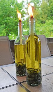 Bug repelling tiki torches--wine bottles, tiki fuel, a 3/8 washer and a refill tiki wick. Brilliant! So much prettier than the stakes. - must try this idea!  pebble, sea glass, shells....