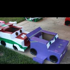 Cars made out of cardboard boxes for a car theme birthday party! My parents made these and painted them! So talented!