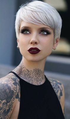 Why would such an attractive woman tattoo herself to the point of being a walking canvas beats me