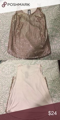 Gold sequined sleeveless shirt Gold sequined sleeveless shirt NWT. Very comfortable fit. Dress this down with some jeans and booties or keep it dressy! Tops Blouses