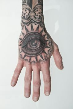 Thomas Hooper Hand Tattoo Eye