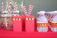 "Wrapped mini juice boxes in red paper and pasted ""eyes"" (shrunk them down from original google image used on goodie bags)  = Ninjago lego juice boxes"