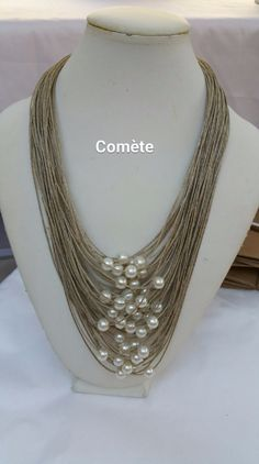 Items similar to This linen thread and pearly ivory beads necklace, is bird eye shape. on Etsy - This linen thread and pearly ivory beads necklace is image 0 - Diy Jewelry Rings, Pearl Jewelry, Jewelry Crafts, Beaded Jewelry, Jewelery, Jewelry Making, Fabric Necklace, Fabric Jewelry, Diy Necklace