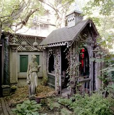 every garden needs a gothic gingerbready potting shed. and St Francis.