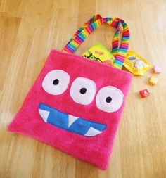 Cute handmade monster trick or treat tote with rainbow lining
