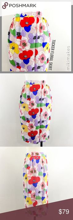 """🆕 TUCKER • silk floral print skirt button front • how beautiful is this silk skirt from Tucker? • gorgeous multicolor floral print • elastic back waist • double pink button front that folds over to close • side seam pockets • not lined • just came back from the dry cleaners, excellent condition  100% silk  ✂️  Waist = 32"""" ✂️  Hip = 42"""" ✂️  Length = 25""""  • sorry no trades • please feel free to ask any questions  ❤️,  @mikimakes  062617.12.79 Tucker Skirts Midi"""