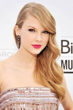 Taylor Swift's Beauty Transformation - 2011: Taylor Swift's bright pink lips get all the attention at the Billboard Music Awards.