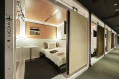 A new generation of capsule hotels is reinventing the tiny-hotel industry with cool tech and hip designs. Here are Tokyo's top pods Capsule Hotel Japan, Deco Spa, Sleeping Pods, Hotel Safe, Hotel Room Design, Tokyo Hotels, Hotel Interiors, Interior Design, Beach Cottages