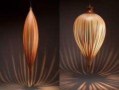 Plumb sculptural pendant lights made from yellow cedar and cherry by Peter Pierobon.