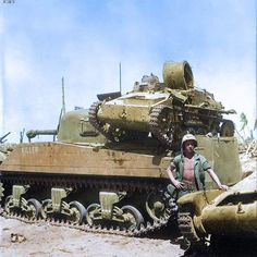 """the_ww2_memoirs A M4A2 tank """"Killer"""" from the 4th Marine Tank Battalion carries a Type 94 light-tank as a trophy on its back on the island Namur, March, 1944. The M4A2 Sherman tank in the photograph also is equipped with wooden planks on its sides to prevent Type 99 magnetic anti-tank mines from sticking the the tank. I actually didn't know this little fact so thank you WW2 Colorized Photos on Facebook! (That's where I get all these amazing photos from!) Adding materials to prevent anti-tank…"""