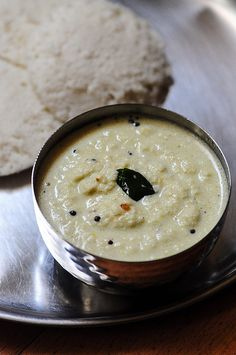 Tamil Coconut Chutney (for Idli-Dosa) Ingredients: 1 cup of grated coconut 1/3 cup of pottukadalai or roasted Bengal gram 2-3 green chillies (adjust to your heat levels) 3/4 tsp of salt 2 tsp of oil 1/4 tsp of musard seeds 1/4 tsp of ulutham paruppu or urad dal 5-6 curry leaves 1 fat pinch of perungaayam or hing