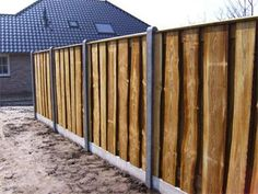 Grote foto met plaatsing lariks schutting 69 per meter tuin en terras hekken en schuttingen