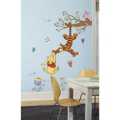 Bring the magic home with these Winnie the Pooh wall decals. Decorate your child's nursery or bedroom with Winnie the Pooh, Tigger and Piglet swinging for honey. These removable decals are easy to install and position.