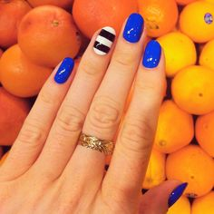 blue nails with striped ring finger nail. pretty!