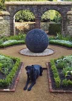 Black lab in a beautiful garden