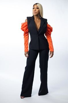 The Ruffle Me Up Long Sleeve Top lends a touch of playful elegance to your everyday wardrobe. Designed in a black hue combined with orange padded sleeves with delicate ruffle detailing, the top is your new weekend staple. Style with your matching black pants and simple gold jewelry for an effortless, elegant look. #topsdesigns #topsforwomen #tops #topsforgirlsstylish #topsdesignsforjeans #topsforwomencasual #topsforgirlscasual #outfit #outfitgoals #cutetops #outfitgoalsclassy #outfitclassy Spring Outfits Classy, Spring Fashion Outfits, Long Tops, Long Sleeve Tops, Staple Design, Casual Tops For Women, Night Outfits, Everyday Outfits, Elegant Dresses