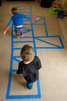 """Masking tape """"rope ladder"""".  It would be interesting to also try to make an outline of a huge ship too for the kids to climb around."""