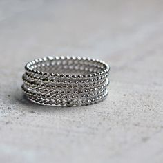 Sterling silver bead wire stacking rings. A set of 6 simple but truly unique rings. Delicate but strong! I have a pair that I wore on an epic trip to Nicaragua and they survived huge surf, volcano boa