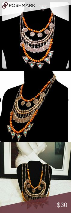 New statement necklace with marching earrings Burnish gold metal statement necklace set wit black beads and charms. Lobster clasp closure Jewelry Necklaces