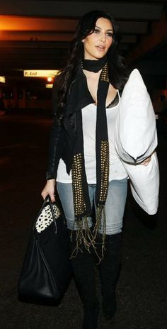 Who made Kim Kardashian's black purse, jeans and black scarf that she wore at LAX Airport, January 18, 2010? Purse – Hermes  Jeans – Bebe  Scarf – Tolani Studded