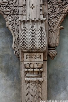 The detailed work in this old archway makes this piece special and a dramatic element against the beautifully painted outside wall.