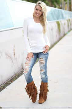 Every girl needs the perfect boot and these have FRINGE! These boots can be dressed up or dressed down! Perfect for an occasion. Wear with our super distressed skinny jeans or how bout pair it with a cute short dress! This one is definitely a MUST HAVE! Check out some amazing accessories and leg warmers at our online boutique!