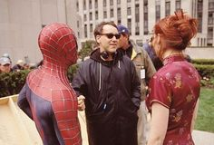 Director SAM RAIMI discusses a scene with stars TOBEY MAGUIRE (as Spider-Man) and KIRSTEN DUNST on the set of Columbia Pictures' action adventure SPIDER-MAN. ®... #{T.R.L.}