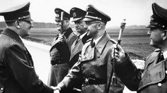Adolf Hitler being greeted by Himmler