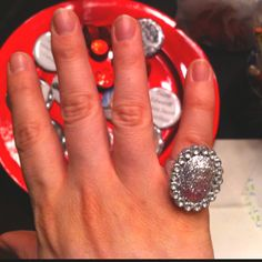 Cheap party store little girl princess party rings + a small glob of glitter paint = Bella's engagement ring :-p
