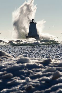 *Water crashes into the Ludington Lighthouse in lower Michigan.