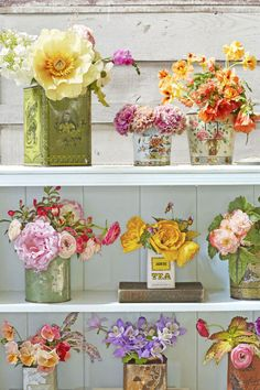 Vintage Tea Tins Using old tea tins, make an eclectic group of bouquets to decorate your holiday table.