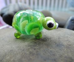 Cute large glass lampwork bead.... handcrafted Turquoise in light and dark greens, tortoise bead by BdazzledJewellery on Etsy
