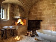 Stone bathroom with fireplace