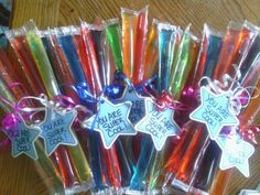 """End of the year student gifts for my daughter Amaya's 3rd grade class. Very Easy and cheap to make :) Just get some """"cool"""" pops, ribbon, and a tag of your choosing to make."""