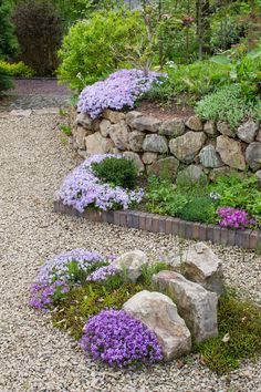 Gravel, stones, bricks and flowers