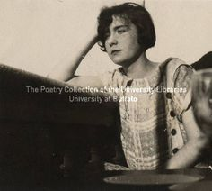 Lucia Joyce seated at table, Ostend :: James Joyce Collection :: Digital Collections :: University at Buffalo Libraries