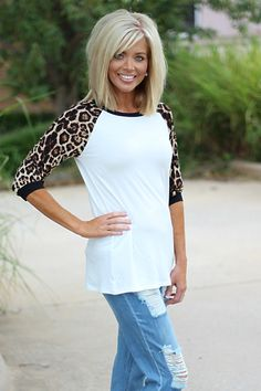 Our White Raglan Top with Leopard Print Sleeves is made of Rayon and Spandex and measures approximately long from shoulder to hem. This top is available in sizes Small, Medium, Large, and X-Large.One Faith Boutique is a women's trendy clothing bout Trendy Clothes For Women, Trendy Outfits, Trendy Clothing, Medium Hair Styles, Short Hair Styles, Leopard Print Hair, Medium Layered Hair, My Hairstyle, Dark Hair