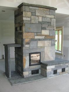 beautiful example of a masonry heaters. If you're going to have a fireplace make it a functional one.