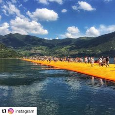Simply thanks @instagram Lake Iseo near Brescia Italy is glowing gold. The Floating Piers a project from Bulgarian-American artist Christo Vladimirov Javacheff (known as Christo) opened one week ago. Marco Giovannelli (@marcogio59) was one of the first of 350000 visitors to experience the yellow fabric road. Its a unique experience that allows people to travel a route that didnt exist before Marco says. There isnt quite anything like it. The nearly 2-mile-long (3-kilometer) pathway was…