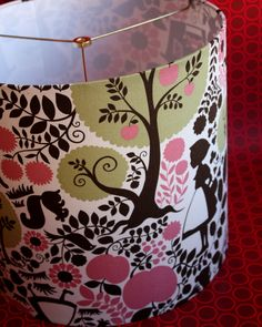 Lampshade featuring Kokka Little Red Riding Hood story on bright, off-white duck.  www.etsy.com/shop/dmccaulla