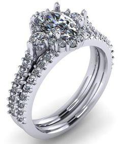 Double-banded oval engagement ring. Side stones. Halo ring. White gold.  #seneedhamjewelers #loganutah 117855C