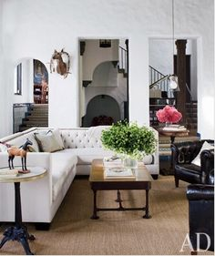 Now that we're in the living room, I have two issues to talk about – paneling and the floor. The choice I have here is whether I should go with sisal or a soft carpet or rug – or maybe I should even use both. Which would YOU choose?