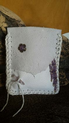 White Deer Hide With Many Different Amethyst Stones Created by Marsha-Tate Donnell Fox Run Leather Designs