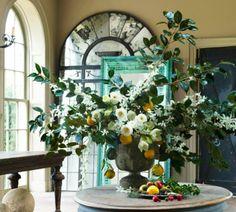 Gorgeous Christmas centerpiece featured in Veranda. Natural floral greens, lemons, white flower arrangement