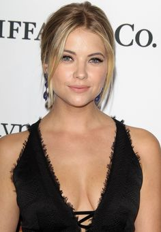 Ashley Benson. Off-center part, face framing pieces and volume at top.